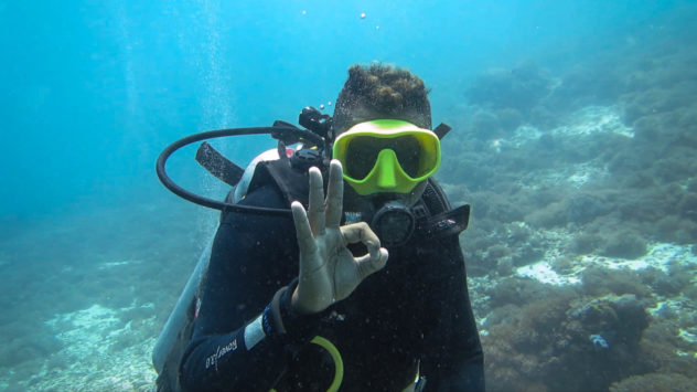 This diving hand signal is used to ask if a diver is OK. The OK hand signal is the most common diving hand signal that is used